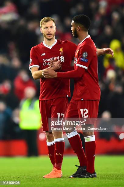 Liverpool's Ragnar Klavan congratulates Joe Gomez at the end of the match during the UEFA Champions League Round of 16 Second Leg match between...