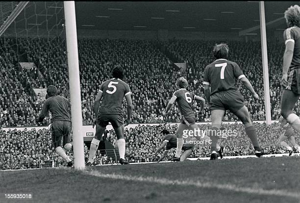 Liverpool's Ray Kennedy dives watched by John Phillips Micky Droy Steve Wicks of Chelsea and Liverpool's Kenny Dalglish during the league division...