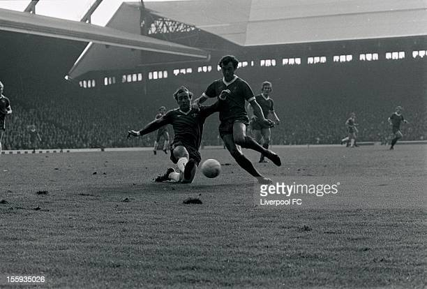 Liverpool's Ray Kennedy is tackled during the league division one match between Liverpool and Chelsea at Anfield on October 8 1977 in Liverpool...
