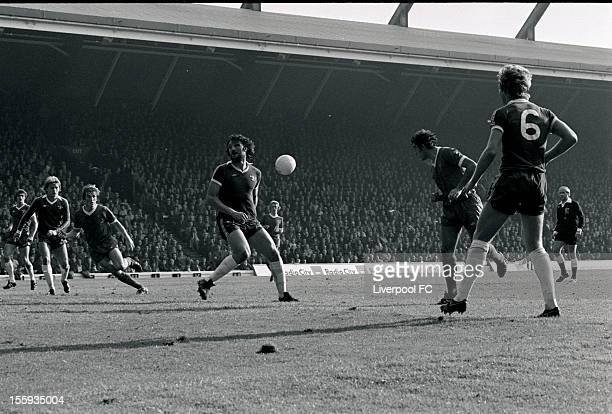 Liverpool's Ray Kennedy nods the ball across to Kenny Dalglish who goes on to score the opening goal during the league division one match between...