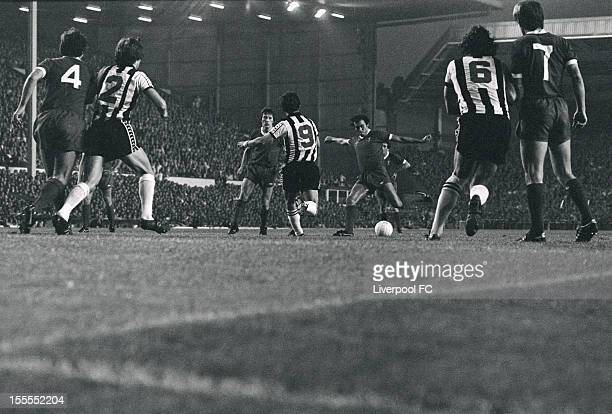 Liverpool's Ray Kennedy strikes the ball watched by Tommy Smith Irving Nattrass John Bird and Kenny Dallgish during the Division One match between...