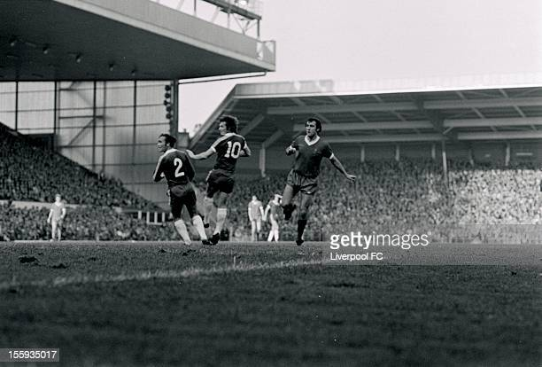 Liverpool's Ray Kennedy tries a shot past Ron Harris and Kenny Swain of Chelsea during the league division one match between Liverpool and Chelsea at...