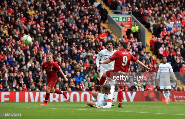 Liverpool's Robbie Fowler scores his side's first goal of the game during the Legends match at Anfield Stadium Liverpool