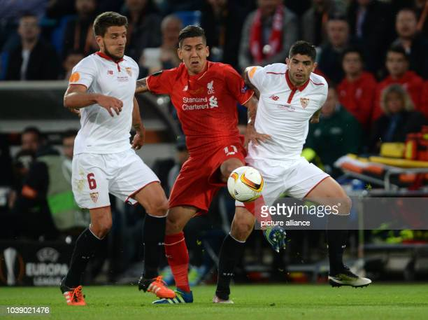 Liverpool's Roberto Firmino and Sevilla's Daniel Carrico and Ever Banega vie for the ball during the UEFA Europa League final between Liverpool FC...