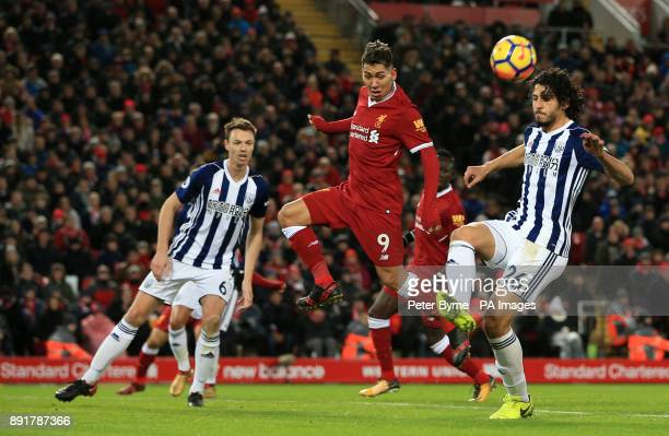 Liverpool's Roberto Firmino and West Bromwich Albion's Ahmed Hegazy battle for the ball during the Premier League match at Anfield Liverpool
