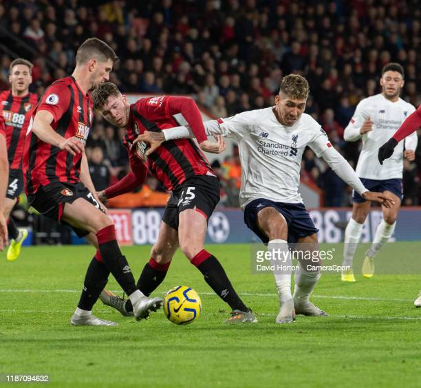 Liverpool's Roberto Firmino battles for possession with Bournemouth's Chris Mepham and Jack Simpson during the Premier League match between AFC...