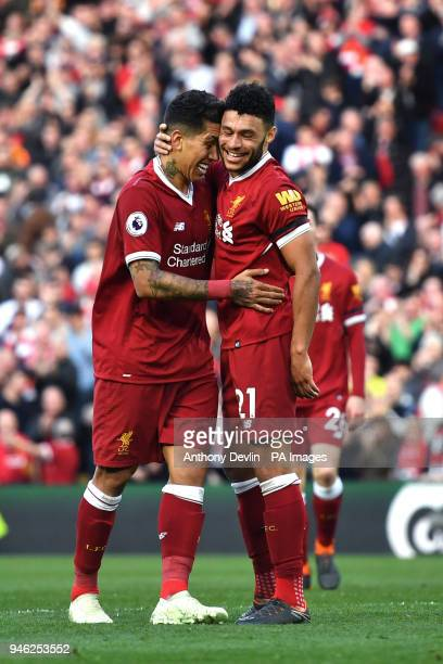 Liverpool's Roberto Firmino celebrates scoring his side's third goal of the game during the Premier League match at Anfield Liverpool