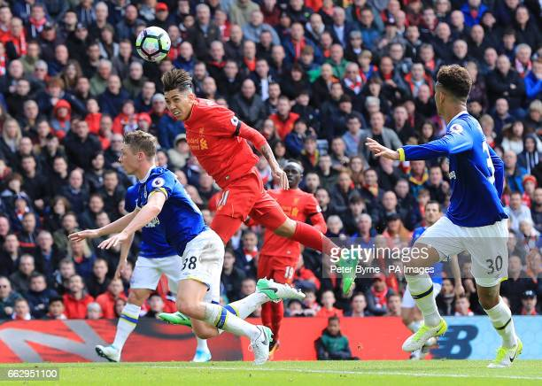Liverpool's Roberto Firmino in action with Everton's Matthew Pennington during the Premier League match at Anfield Liverpool