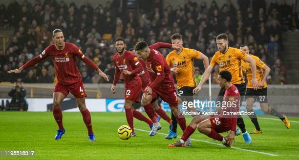 Liverpool's Roberto Firmino scrambles from defence during the Premier League match between Wolverhampton Wanderers and Liverpool FC at Molineux on...