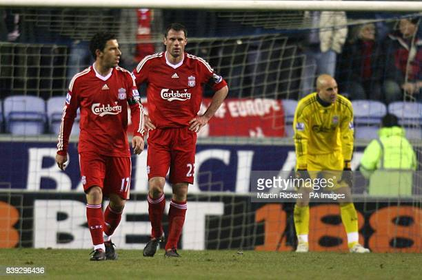 Liverpool's Rodriguez Maxi Jamie Carragher and goalkeeper Jose Reina show their dejection after conceding their first goal of the game
