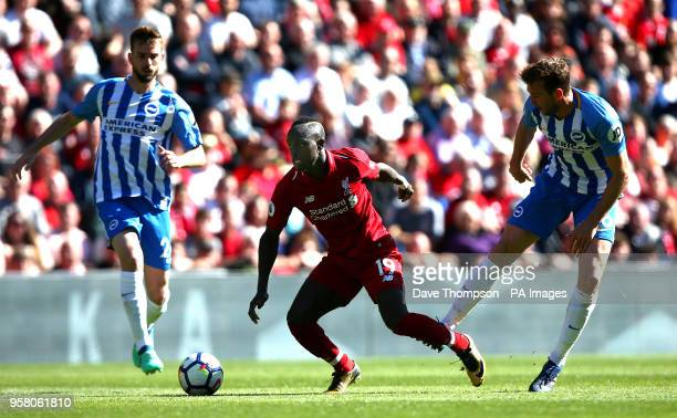 Liverpool's Sadio Mane and Brighton Hove Albion's Dale Stephens battle for the ball during the Premier League match at Anfield Liverpool