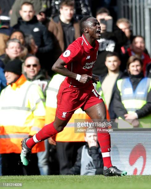 Liverpool's Sadio Mane celebrates scoring his side's first goal of the game during the Premier League match at Craven Cottage London