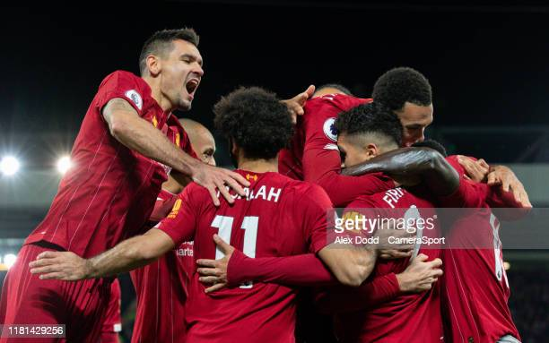 Liverpool's Sadio Mane celebrates scoring his side's third goal with teammates during the Premier League match between Liverpool FC and Manchester...