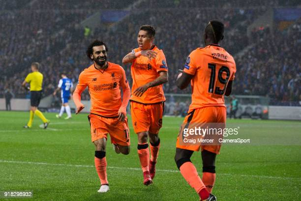 Liverpool's Sadio Mane celebrates scoring his side's third goal with team mates Mohamed Salah and Roberto Firmino during the UEFA Champions League...
