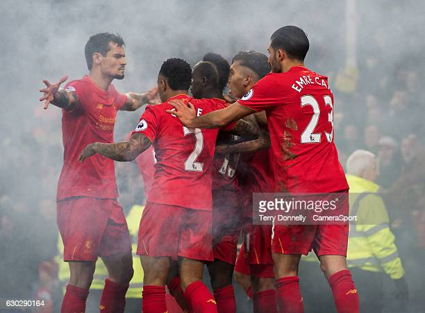 Liverpool's Sadio Mane celebrates with teammates after scoring Liverpool's first goal during the Premier League match between Everton and Liverpool...