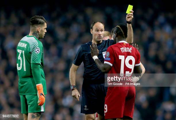 Liverpool's Sadio Mane is booked by match referee Antonio Miguel Mateu Lahoz during the UEFA Champions League Quarter Final at the Etihad Stadium...