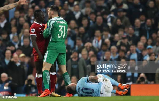 Liverpool's Sadio Mane is confronted by Manchester City goalkeeper Ederson after a challenge on Manchester City's Nicolas Otamendi during the UEFA...
