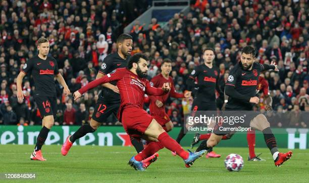 Liverpool's Sadio Mane shoots from close range despite the attentions of Atletico Madrid's Felipe during the UEFA Champions League round of 16 second...