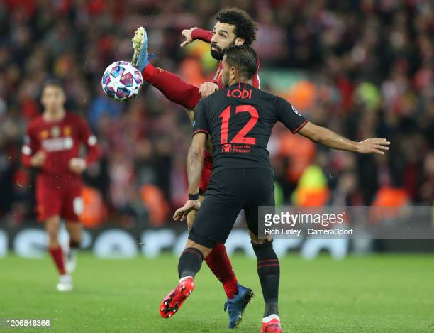 Liverpool's Sadio Mane vies for possession with Atletico Madrid's Renan Lodi during the UEFA Champions League round of 16 second leg match between...