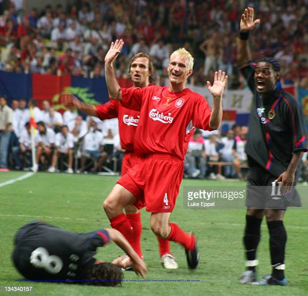 Liverpool's Sami Hyypia protests his innocence to the assistant referee in the UEFA Super Cup at the Stade Louis II, in Monaco, on August 25, 2005....