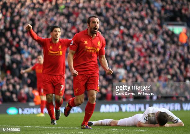 Liverpool's Sanchez Jose Enrique celebrates scoring his side's third goal of the game as Swansea City's Ben Davies lies dejected