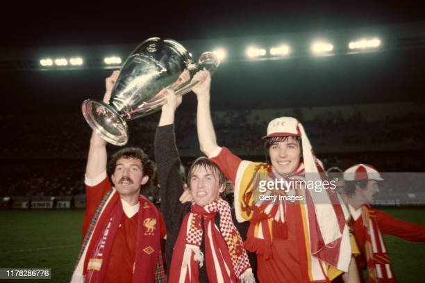 Liverpool's Scotland players from left to right Graeme Souness Kenny Dalglish and Alan Hansen celebrate with the Euopean Cup after their 10 victory...