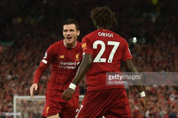 Liverpool's Scottish defender Andrew Robertson and Liverpool's Belgium striker Divock Origi celebrate as Norwich City's Scottish defender Grant...