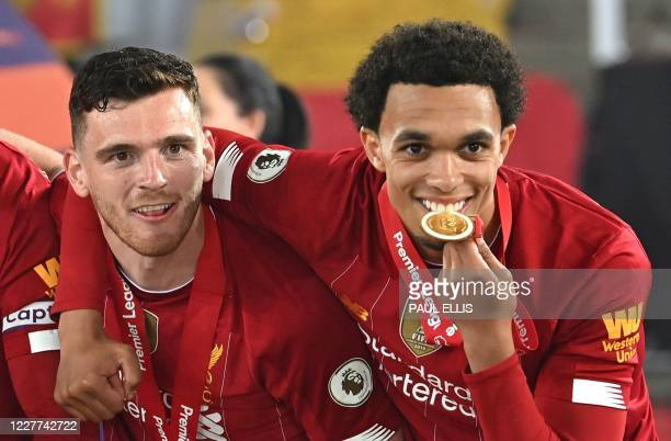 Liverpool's Scottish defender Andrew Robertson and Liverpool's English defender Trent Alexander-Arnold pose during the Premier League trophy...