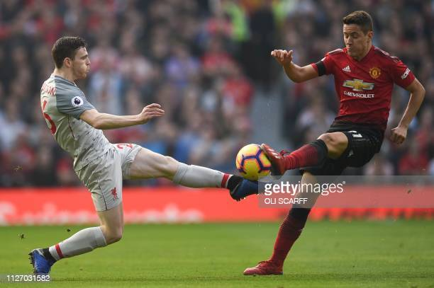 Liverpool's Scottish defender Andrew Robertson and Manchester United's Spanish midfielder Ander Herrera go for the ball during the English Premier...