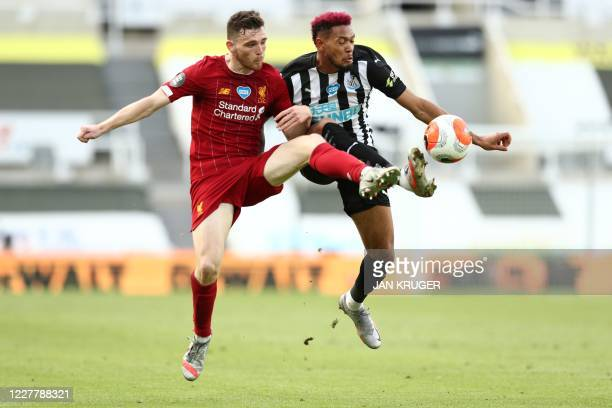 Liverpool's Scottish defender Andrew Robertson and Newcastle United's Brazilian striker Joelinton fight for the ball during the English Premier...