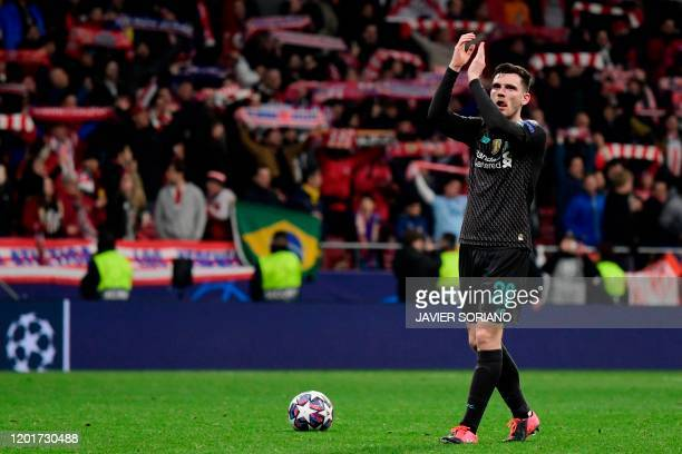Liverpool's Scottish defender Andrew Robertson applauds to fans at the end of the UEFA Champions League, round of 16, first leg football match...