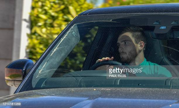 Liverpool's Scottish defender Andrew Robertson arrives at Melwood in Liverpool north west England to resume training on May 20 as training resumes...