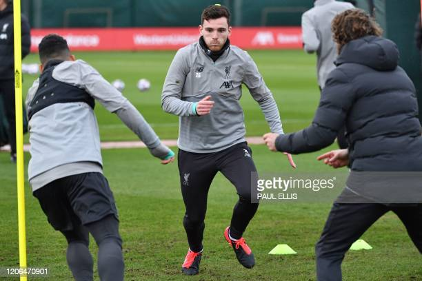 Liverpool's Scottish defender Andrew Robertson attends a training session at Melwood in Liverpool north west England on March 10 on the eve of their...