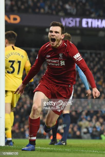 Liverpool's Scottish defender Andrew Robertson celebrates after his cross leads to Liverpool's first goal during the English Premier League football...