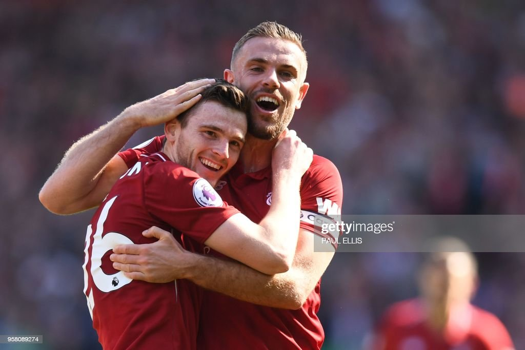 TOPSHOT - Liverpool's Scottish defender Andrew Robertson (L) celebrates after scoring with Liverpool's English midfielder Jordan Henderson during the English Premier League football match between Liverpool and Brighton and Hove Albion at Anfield in Liverpool, north west England on May 13, 2018. (Photo by Paul ELLIS / AFP) / RESTRICTED TO EDITORIAL USE. No use with unauthorized audio, video, data, fixture lists, club/league logos or 'live' services. Online in-match use limited to 75 images, no video emulation. No use in betting, games or single club/league/player publications. /