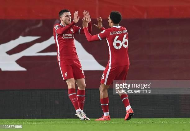 Liverpool's Scottish defender Andrew Robertson celebrates scoring his team's second goal with Liverpool's English defender Trent Alexander-Arnold...