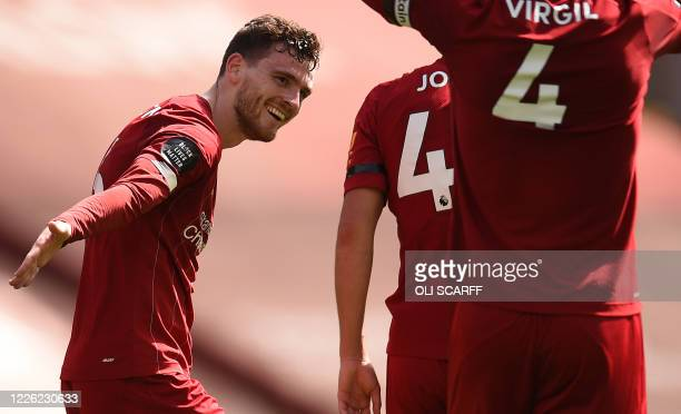 Liverpool's Scottish defender Andrew Robertson celebrates scoring during the English Premier League football match between Liverpool and Burnley at...