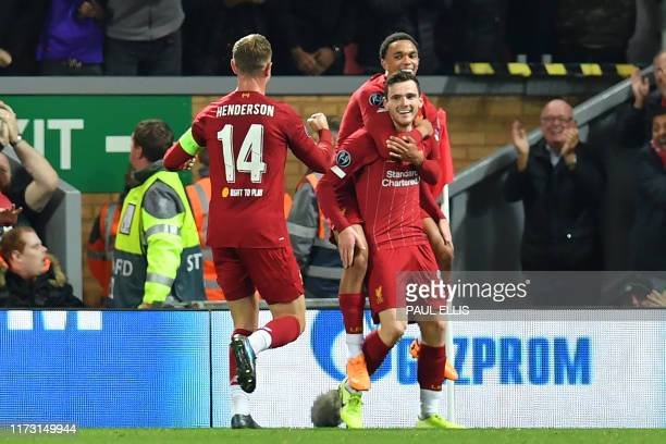 Liverpool's Scottish defender Andrew Robertson celebrates with teammates after scoring their second goal during the UEFA Champions league Group E...