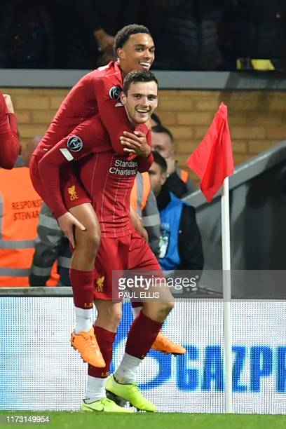 Liverpool's Scottish defender Andrew Robertson celebrates with Liverpool's English defender Trent Alexander-Arnold after scoring their second goal...
