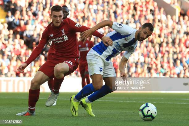 Liverpool's Scottish defender Andrew Robertson challenges Brighton's Spanish defender Martin Montoya during the English Premier League football match...