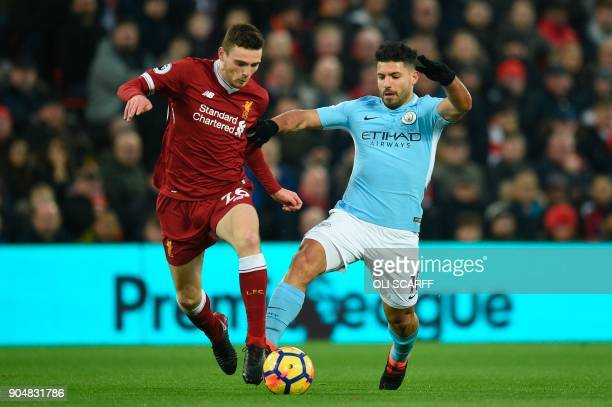 Liverpool's Scottish defender Andrew Robertson challenges Manchester City's Argentinian striker Sergio Aguero during the English Premier League...