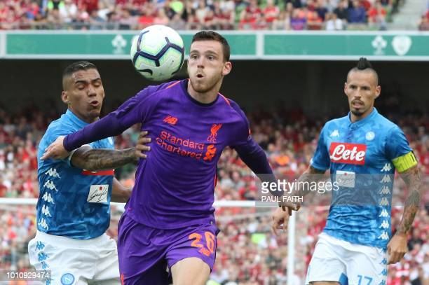 Liverpool's Scottish defender Andrew Robertson chases the ball during the preseason friendly football match between Liverpool and Napoli at the Aviva...
