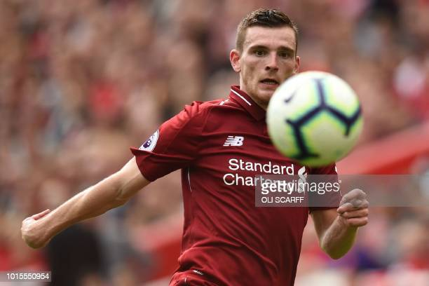 Liverpool's Scottish defender Andrew Robertson chases the ball during the English Premier League football match between Liverpool and West Ham United...