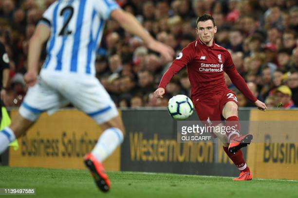 Liverpool's Scottish defender Andrew Robertson controls the ball during the English Premier League football match between Liverpool and Huddersfield...