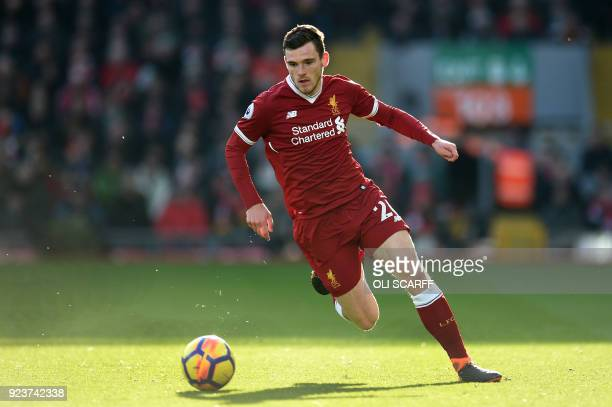 Liverpool's Scottish defender Andrew Robertson controls the ball during the English Premier League football match between Liverpool and West Ham...