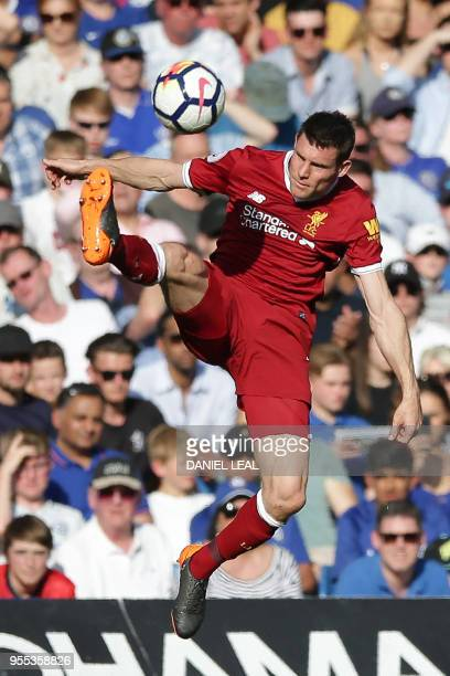 Liverpool's Scottish defender Andrew Robertson controls the ball during the English Premier League football match between Chelsea and Liverpool at...
