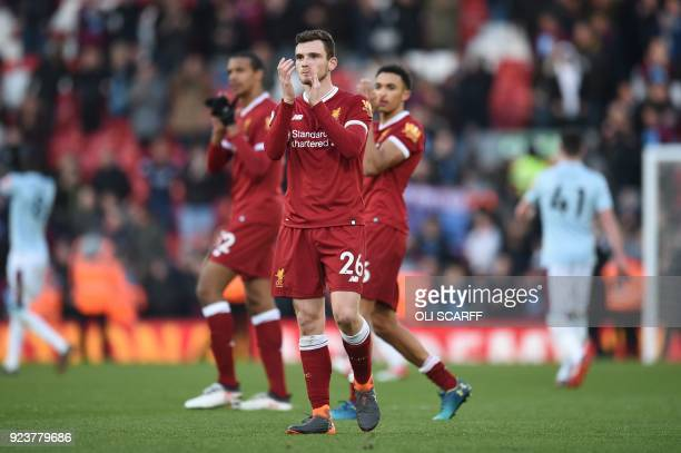 Liverpool's Scottish defender Andrew Robertson gestures at the final whistle of the English Premier League football match between Liverpool and West...