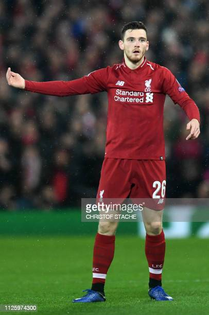 Liverpool's Scottish defender Andrew Robertson gestures during the UEFA Champions League round of 16 first leg football match between Liverpool and...