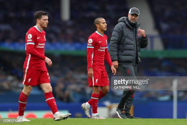 Liverpool's Scottish defender Andrew Robertson , Liverpool's Spanish midfielder Thiago Alcantara and Liverpool's German manager Jurgen Klopp react at...