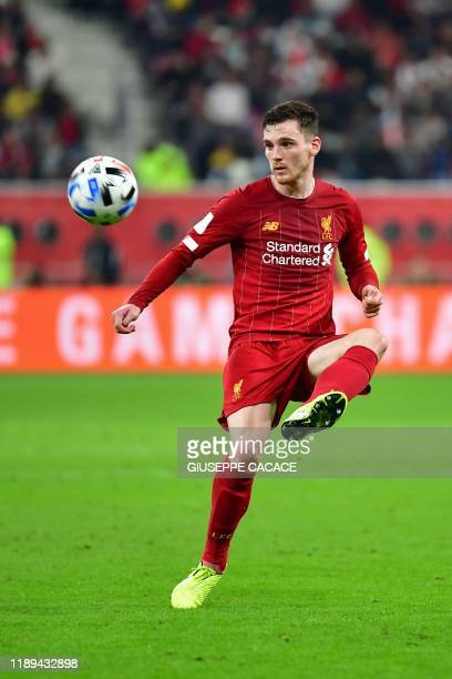 Liverpool's Scottish defender Andrew Robertson passes the ball during the 2019 FIFA Club World Cup semi-final football match between Mexico's...